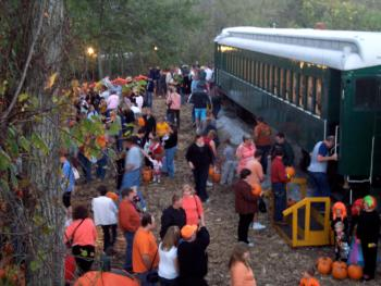 Pumpkins have been selected, and passengers are boarding the train for the return trip to the depot.