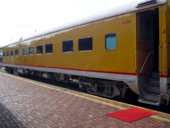 The conductor has the red carpet out, and passengers will soon begin to board the train